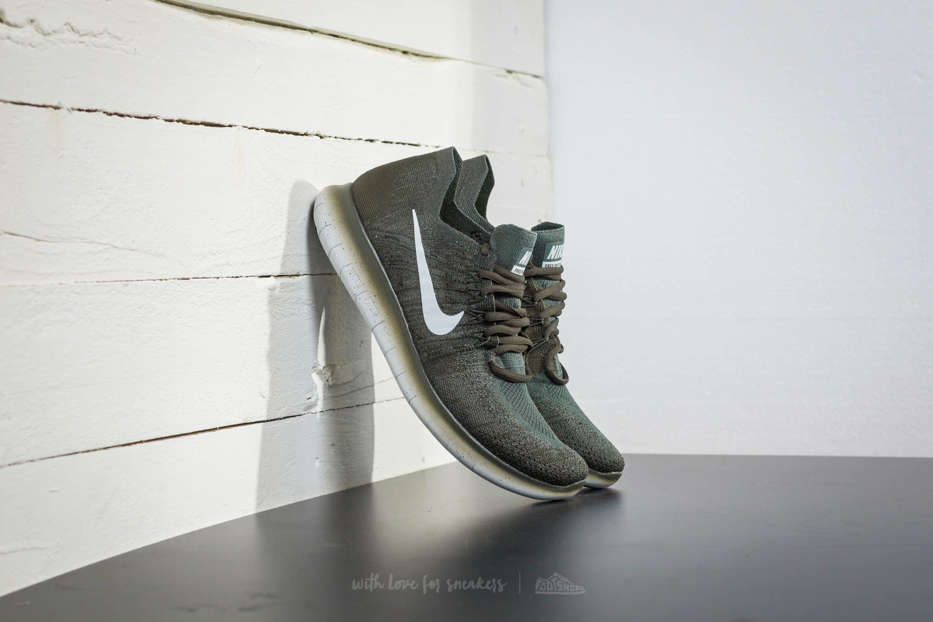 23112c625cb2 Nike Free Run Flyknit 2017 Vintage Green  Pure Platinum