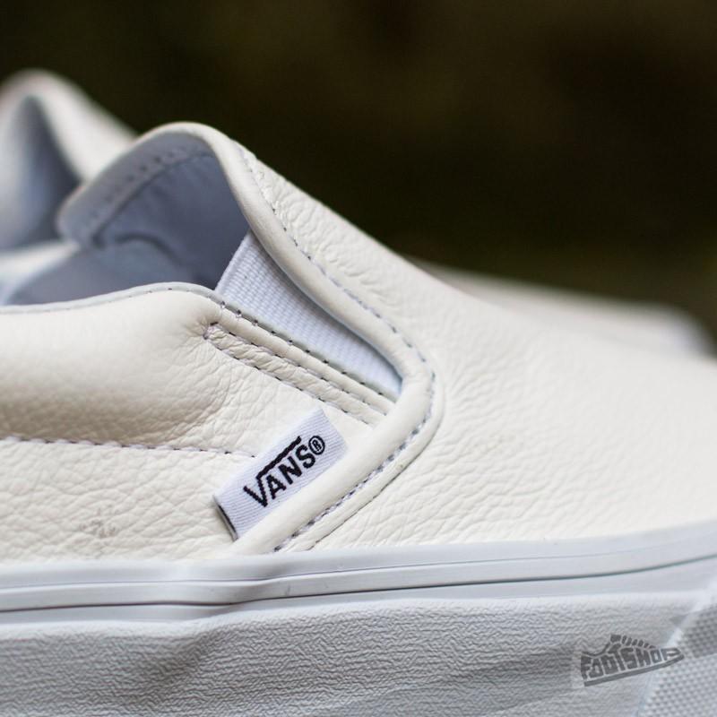 all white leather slip on vans