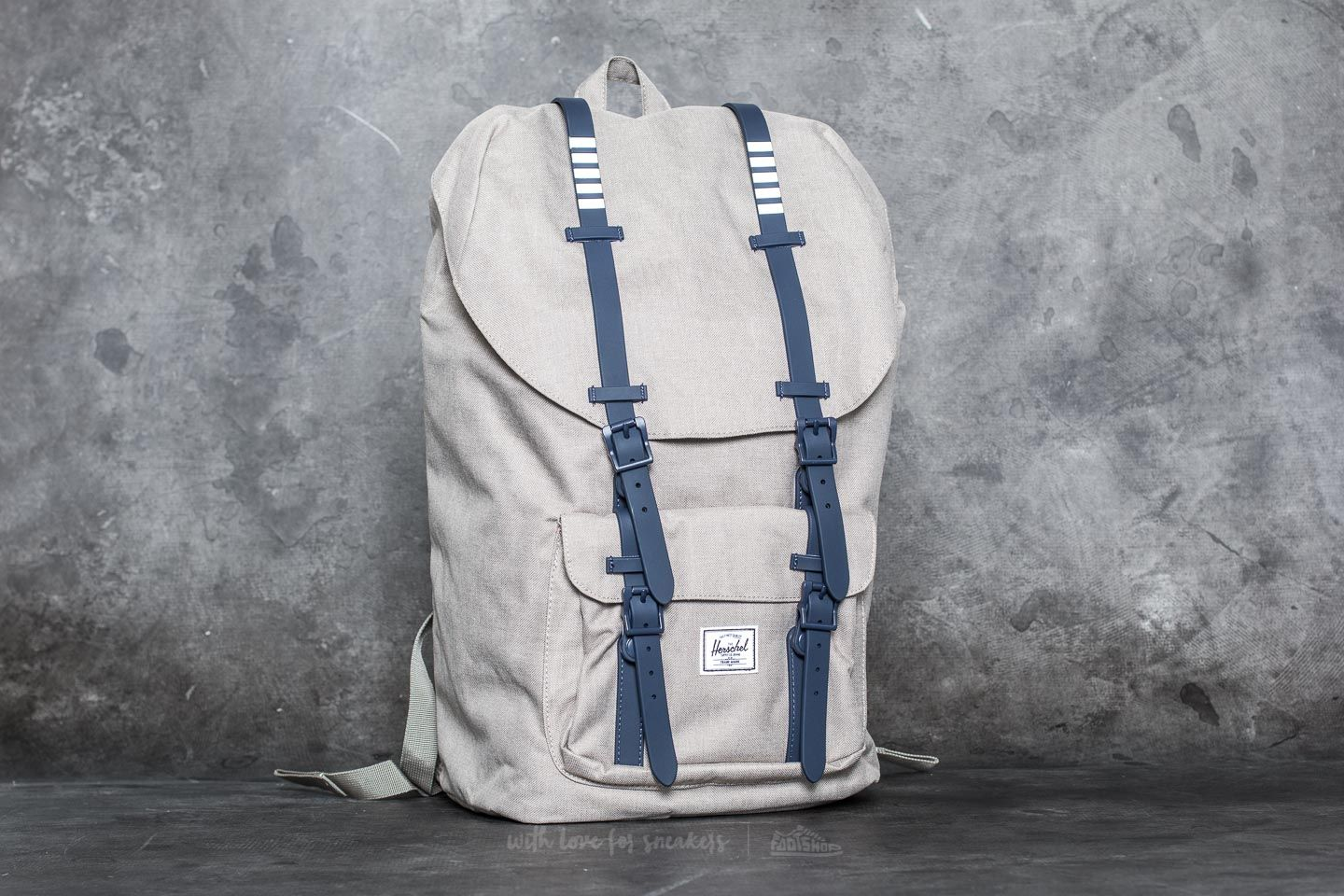 0984b5b2aed Herschel Supply Co. Little America Backpack. Light Khaki Crosshatch  Peacoat  ...