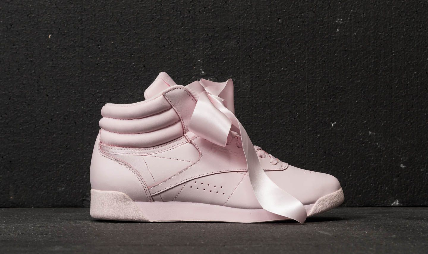 7a6fcf139e9a70 Reebok Freestyle Hi Satin Bow Porcelain Pink  Skull Grey at a great price  110 €