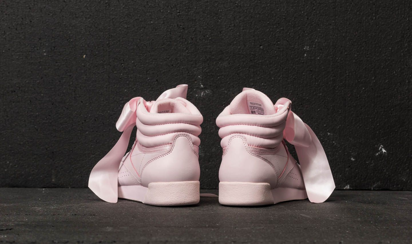 595484d9165a Reebok Freestyle Hi Satin Bow Porcelain Pink  Skull Grey at a great price  £95