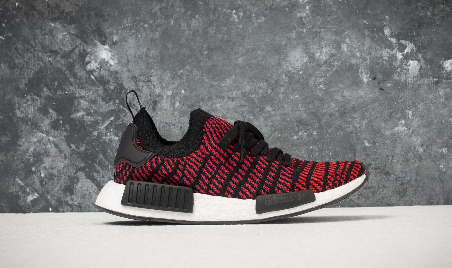 classic fit 255cf 8f841 ... switzerland adidas nmdr1 stlt primeknit red core black red blue at a  great price 060ac ef501
