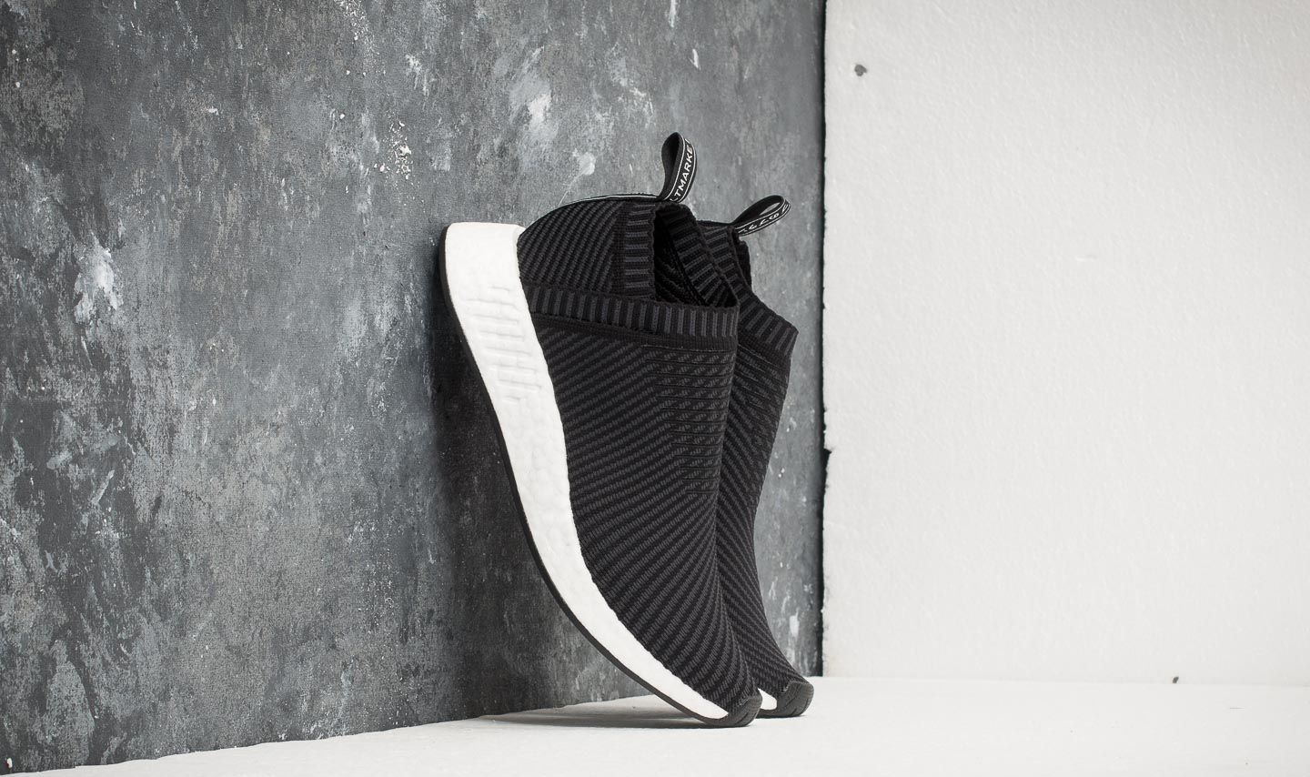 df972ce95 adidas NMD CS2 Primeknit Core Black  Carbon  Red
