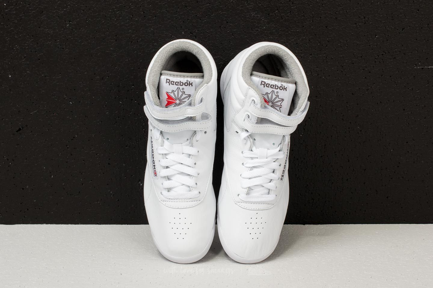 7d29ddf67b5552 Reebok Freestyle Hi White  Carbon  Red  Grey at a great price 83 €