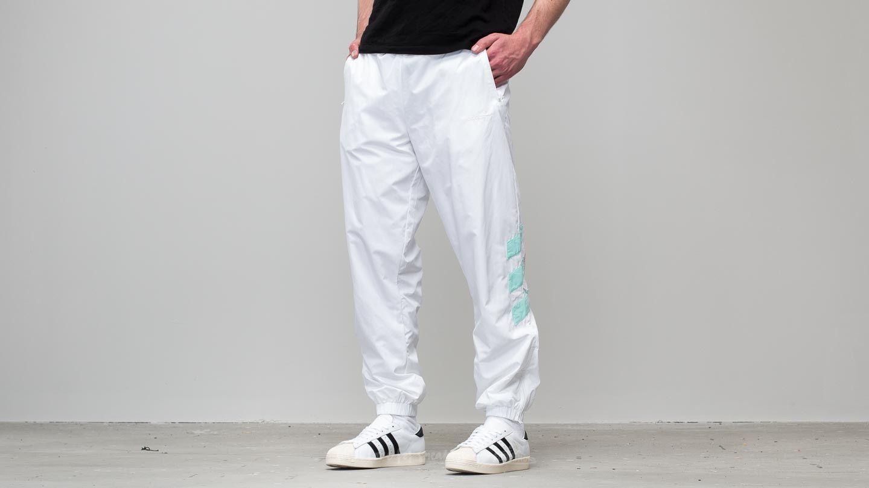 c18e4e6c9d52 adidas Consortium x Nice Kicks Tironti LTD Track Pants White  Energy ...