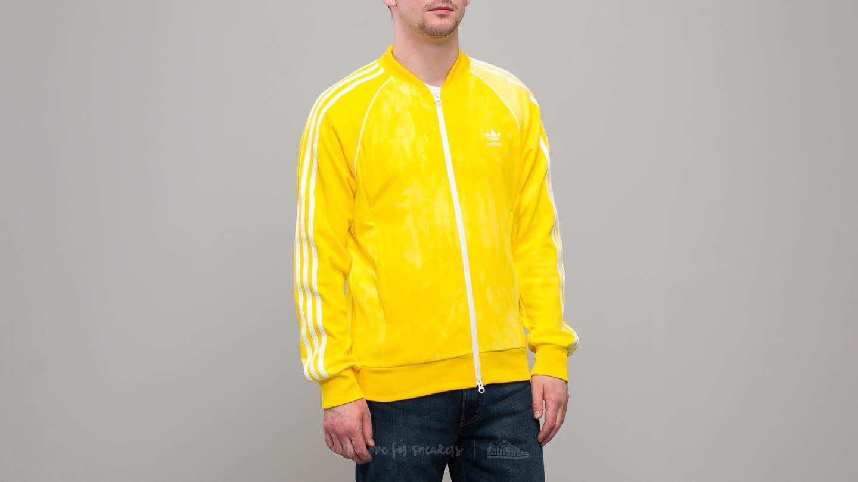 da9d7834c44 adidas x Pharrell Williams HU Holi Superstar Track Top Yellow ...