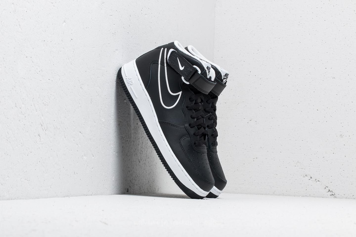big sale 4a817 b2947 Nike Air Force 1 Mid  07 Leather. Black  White