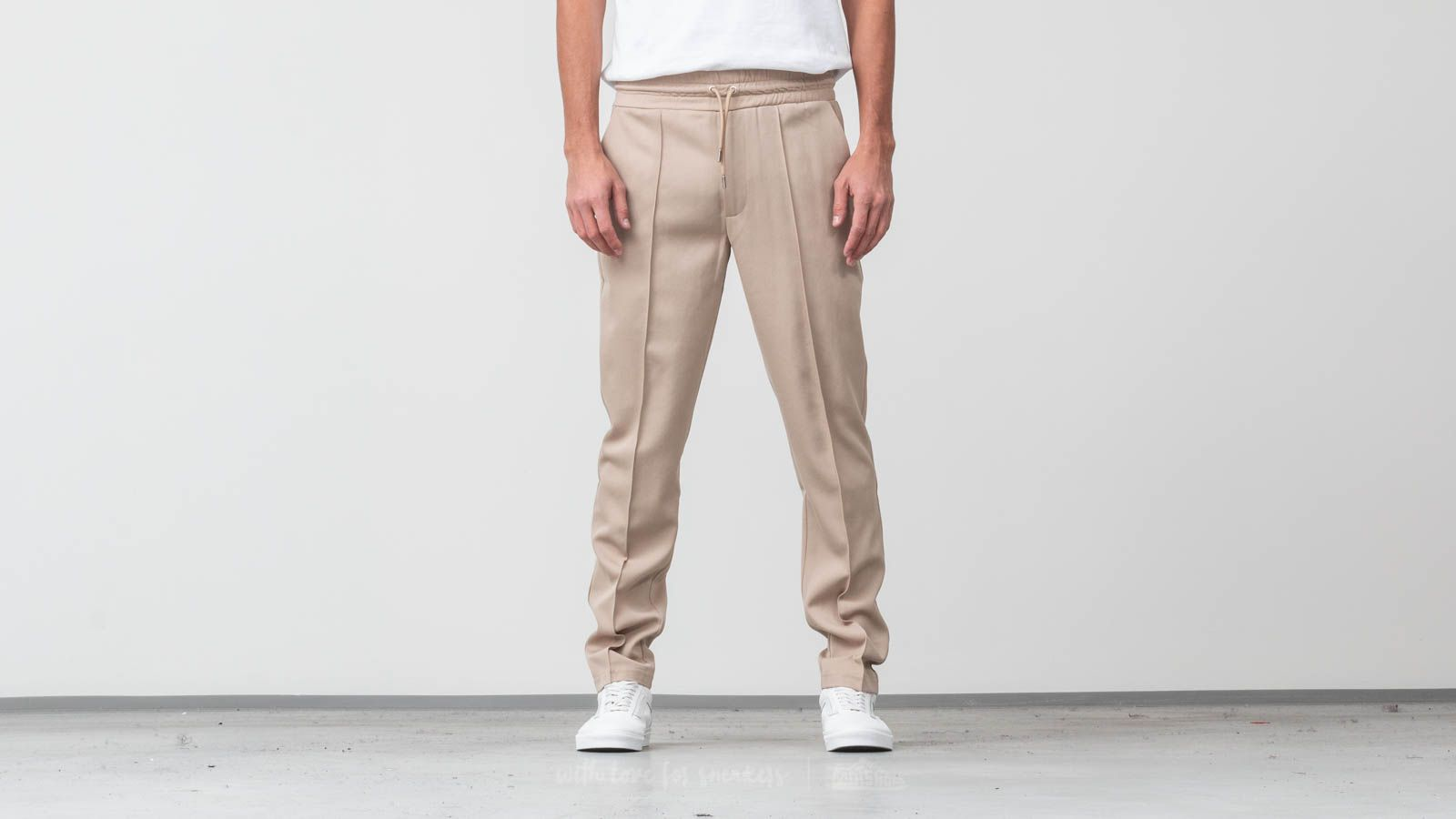 8f4f14ec367517 AXEL ARIGATO Kuro Trousers Beige at a great price £89 buy at Footshop
