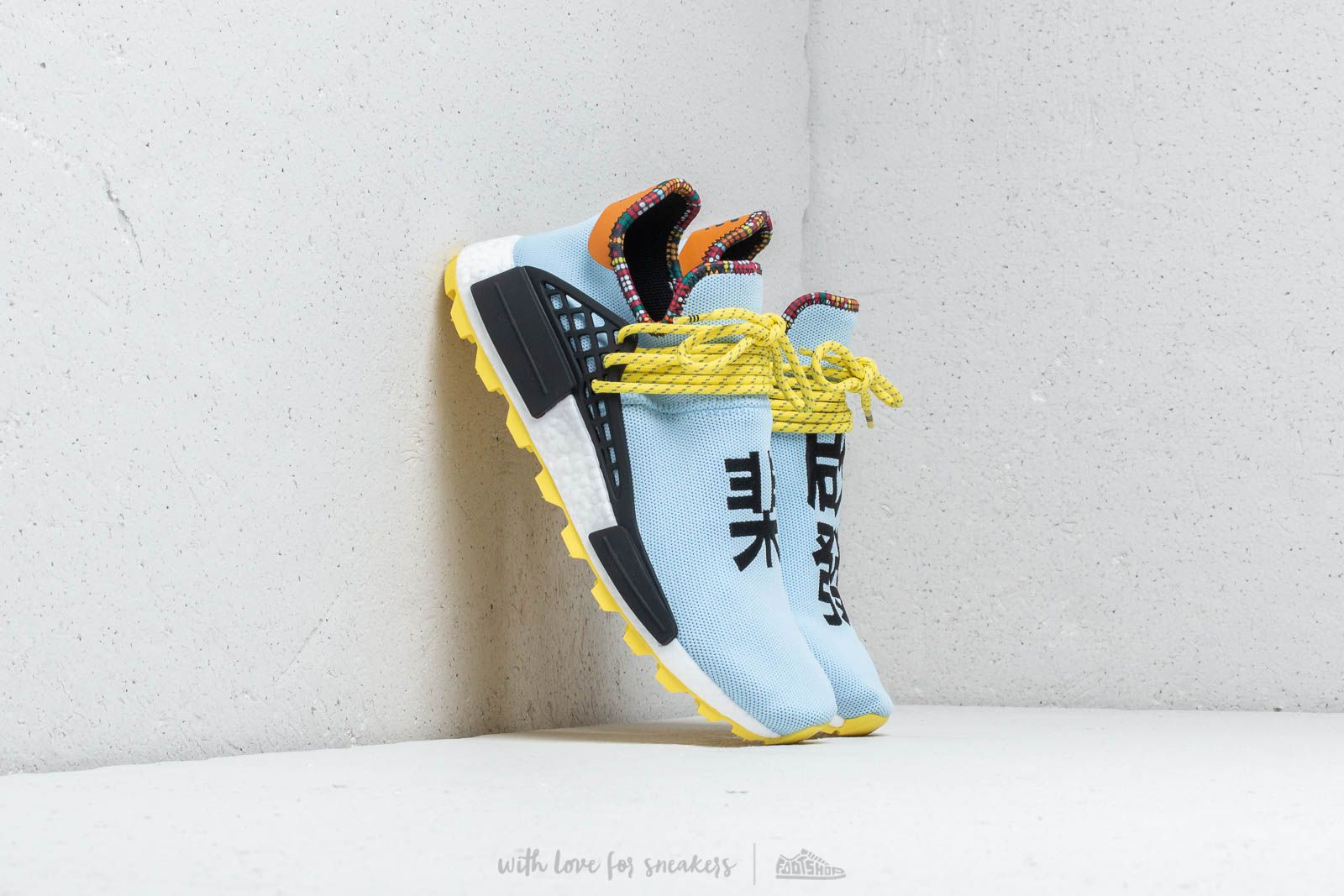 b7a640efc adidas x Pharrell Williams Solar Hu NMD Clear Sky  Core Black  Bold Orange