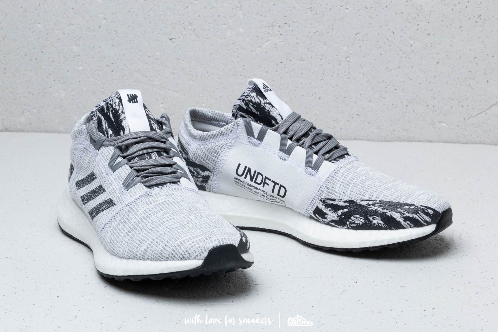 39d53866b0d3b adidas x Undefeated PureBOOST Go Core Black  Core Black  Core Black at a  great