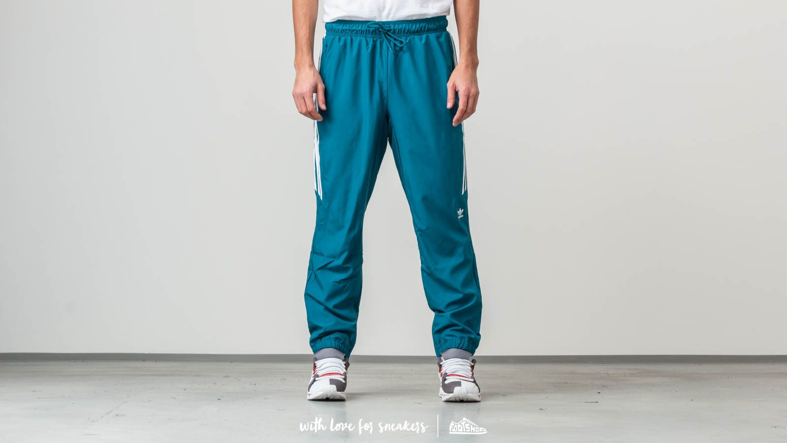 adidas Classic Wind Trackpants Real Teal/ White za skvělou cenu 1 130 Kč koupíte na Footshop.cz
