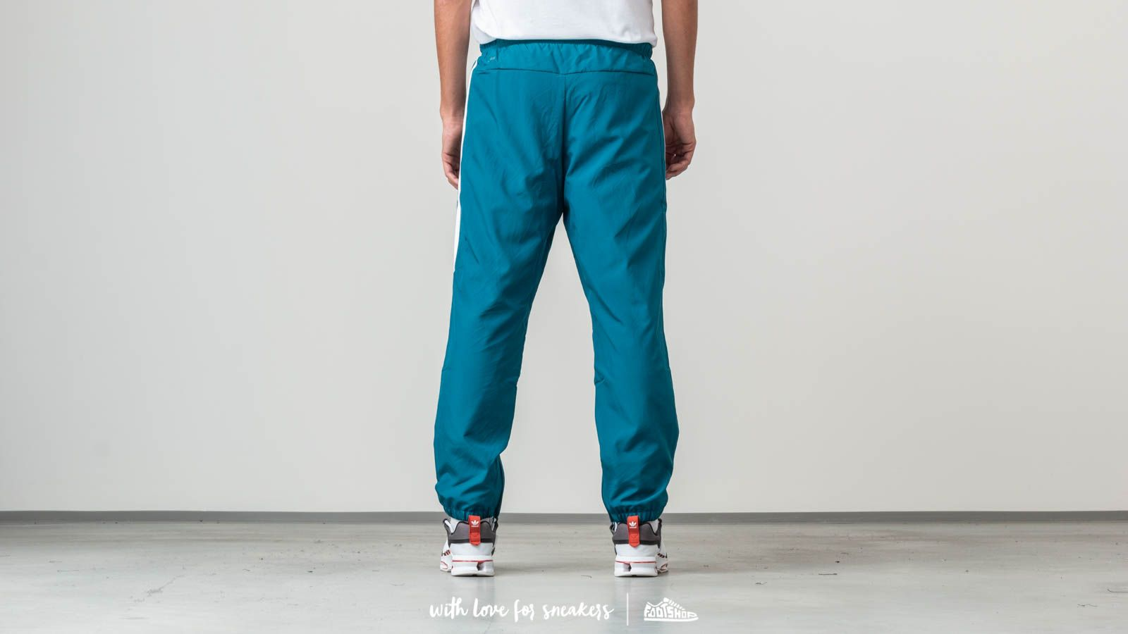 e5a4485c1250 adidas Classic Wind Trackpants Real Teal  White at a great price  82 buy at  Footshop