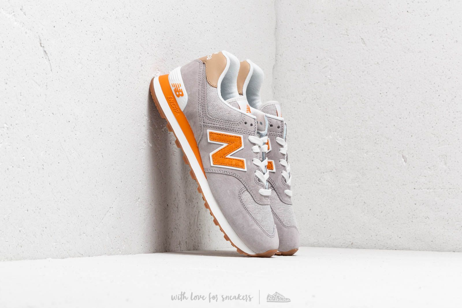 New Balance 574 Grey/ Orange/ White at a great price 92 € buy at Footshop