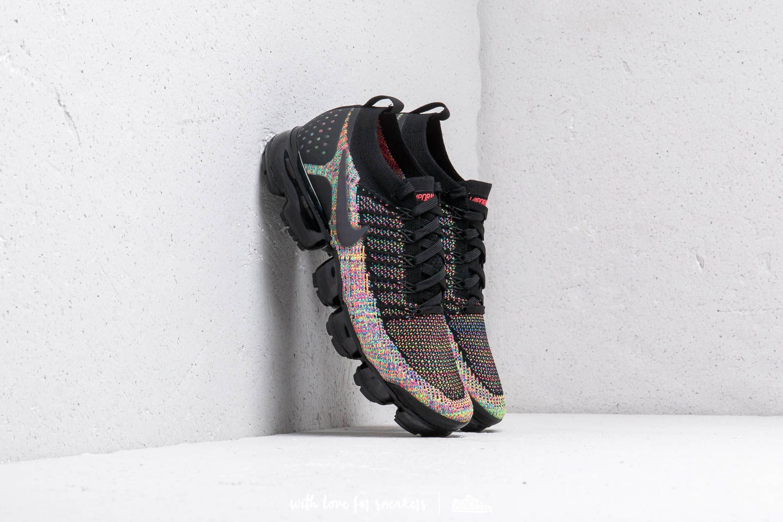 pink blue and black vapormax