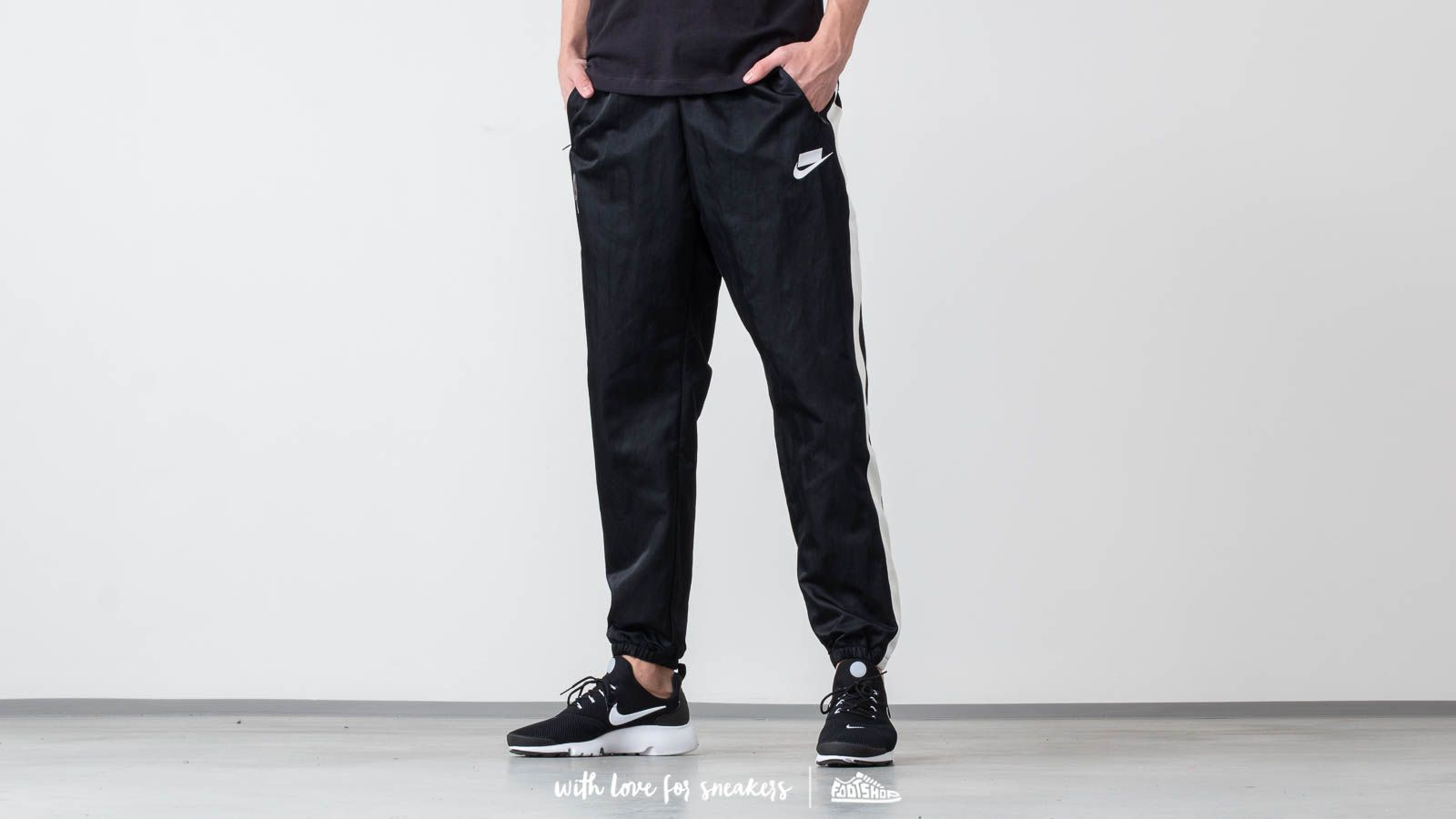 e418a1d430e97 Nike Sportswear Woven Pants Black/ White at a great price $77 buy at  Footshop