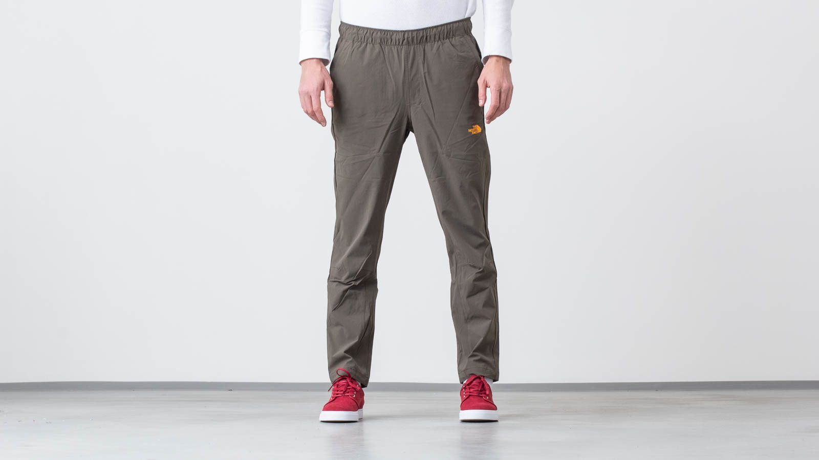 The North Face Tech Woven Pants New Taupe Green/ Zinnia Orange za skvelú cenu 88 € kúpite na Footshop.sk