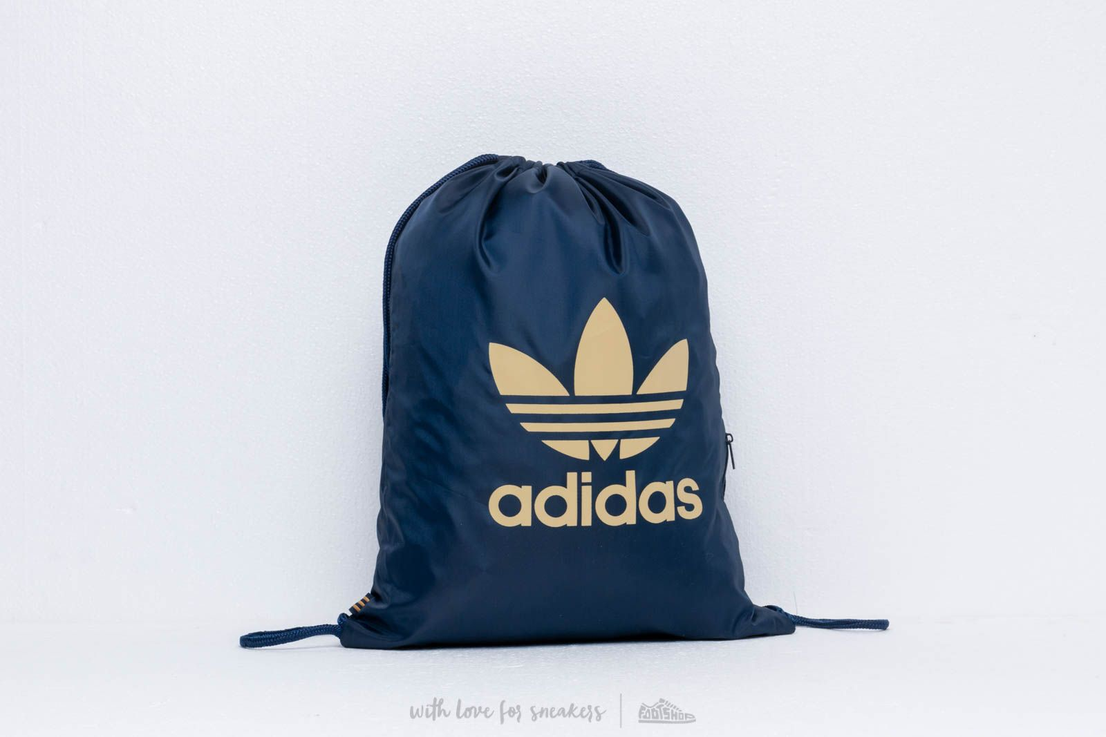 adidas Trefoil Gym Sack Collegiate Navy/ Raw Sand za skvělou cenu 340 Kč koupíte na Footshop.cz