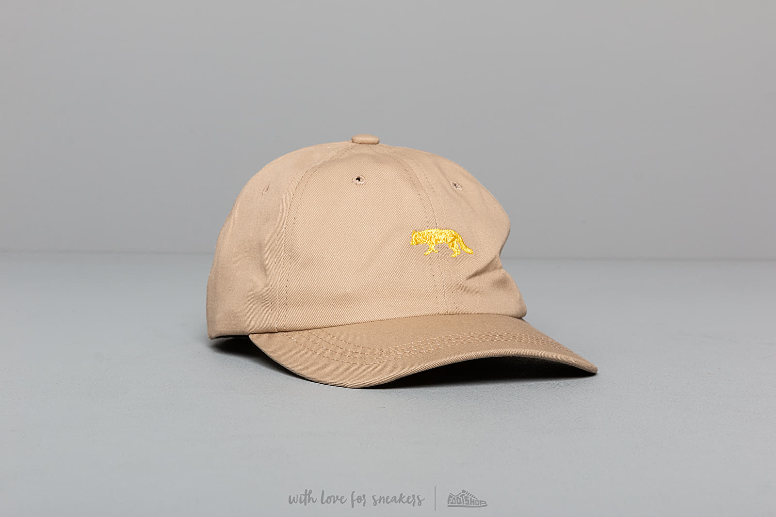 Caps Raised by Wolves Restricted Dad Cap Sand