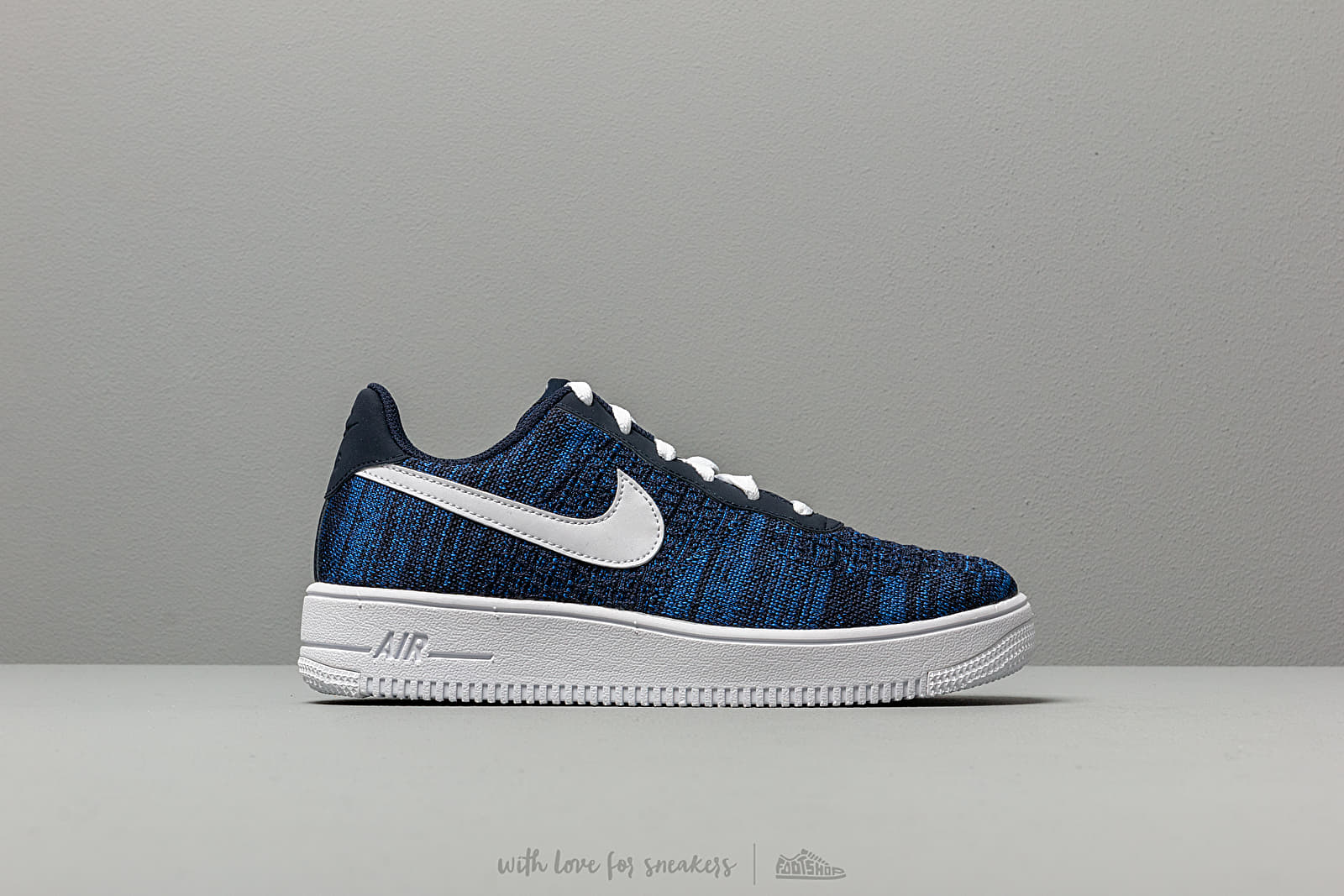 sports shoes 155b0 8904d Nike Air Force 1 Flyknit 2.0 (GS) College Navy  White-Obsidian at