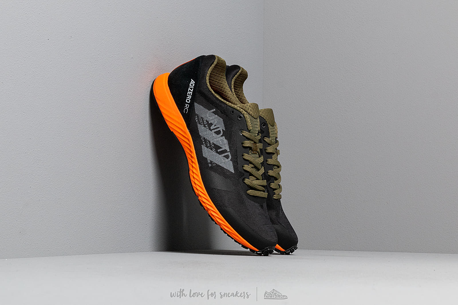 adidas x Undefeated Adizero RC Black-White/ Light Grey Heather/ Orange nagyszerű árakon 32 621 Ft vásárolj a Footshopban