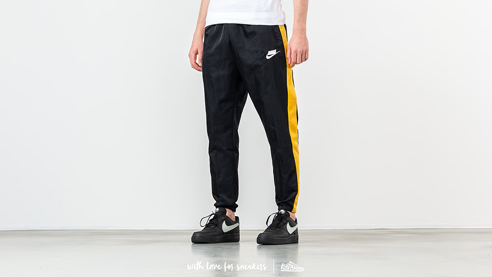 Nike Sportswear Woven Pant Black/ Yellow Ochre/ White at a great price 66 € buy at Footshop