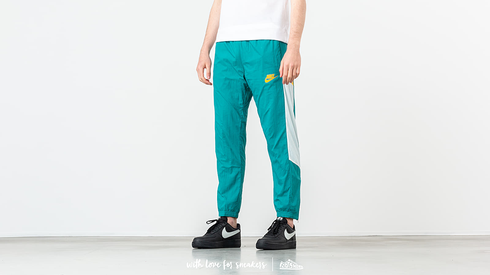 Canvas pants Nike Sportswear Re-Issue Woven Pant Spirit Teal/ Sail/ University Gold