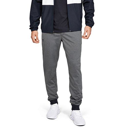 recompensa Deslumbrante cigarrillo  Pants and jeans Under Armour Sportstyle Tricot Jogger Gray