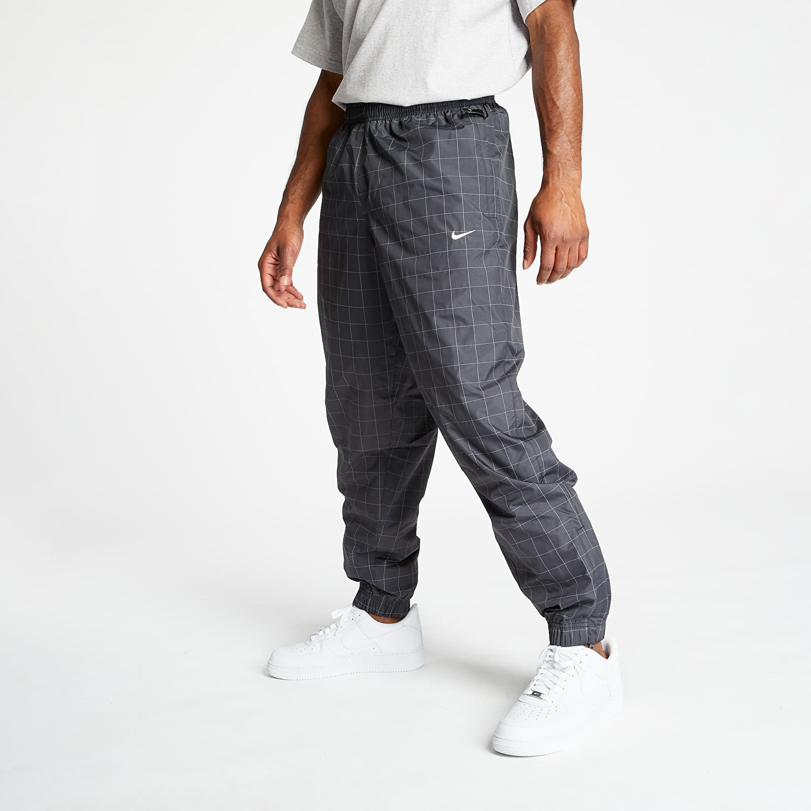 Jeans e pantaloni NikeLab Flash Track Pants Black