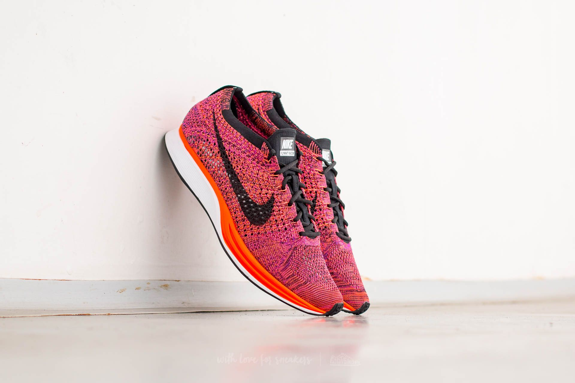 0d82b0f0994b Nike Flyknit Racer Black  Black-Hyper Orange-Vivid Purple