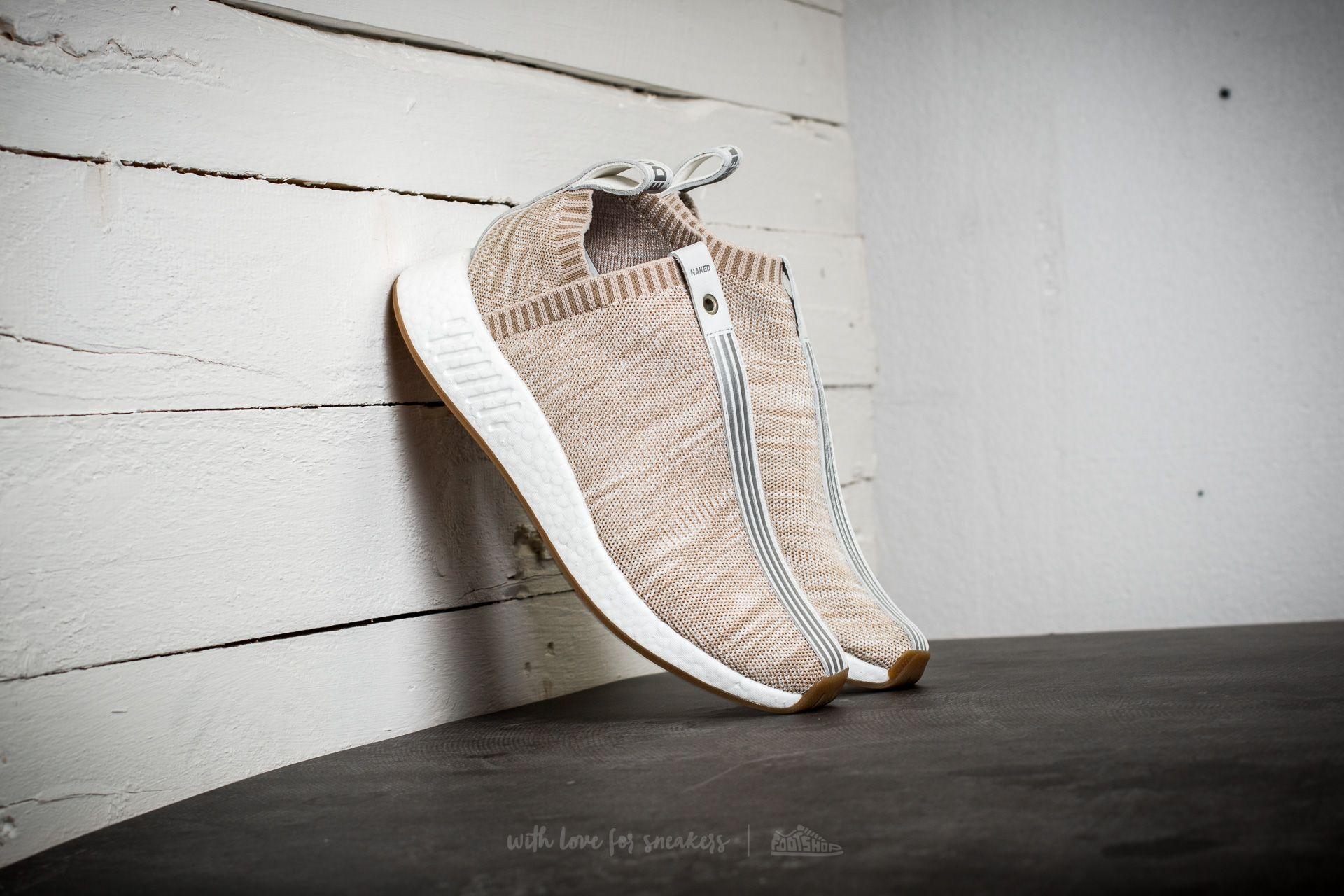 ecd4cc1cef4da adidas Consortium Sneaker Exchange NMD CS2 PK Kith x Naked. Sand  White